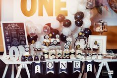 little gentleman 1st birthday party black and white gold bow tie boy moustache candy bar balloons backdrop lamp one presents sweets gingerbread cupcake