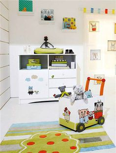 soft toys and kids draqings for toddler bedroom decorating
