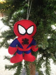 "Spiderman! These handcrafted felt ornaments measure about 6"" tall with about a 3"" loop to hang them with. Price is for each hero. Superhero Ornaments by HebCrafts on Etsy"