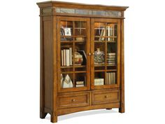 Grandly-scaled with a beautiful design, the Craftsman Home Door Bookcase is a classic piece to outfit your home. Crafted from hardwood solids and Oak veneers, it features a rich American Oak finish that brings warmth to any room with its presence. Decorative slat tile inlays across the top front and ends accent the piece, lending a visually interesting look and feel to its design. Plentiful storage space is provided for your convenience. Two top doors with glass inserts enclose two accent…