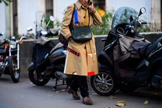Find out how to wear a classic trench coat like a French fashion girl, now on wmag.com.