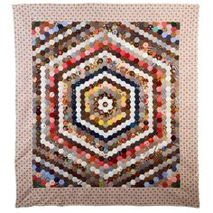 Center Medallion Hexagons Quilt | From a unique collection of antique and modern quilts at https://www.1stdibs.com/furniture/folk-art/quilts/