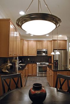 slate floor  black counter maple cabinets kitchen - check out that back splash and how much light is in this kitchen (jealous)