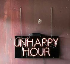 unhappy hour neon sign