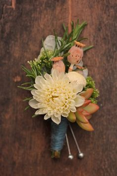 Groom's boutonniere - love the colors of the flowers. not the pinky/peach flower. but the colors and shape