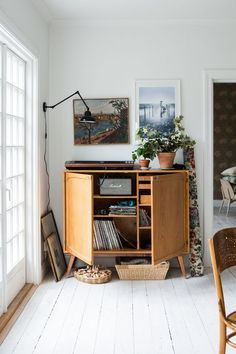 love this wooden cabinet, perfect for a living room