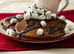 There's nothing better than a hot cup of cocoa on a cold winter's day, and now you can get all that flavor in pancake form (no mug required). They're super simple and ready in 20 minutes; the chocolate flavor comes from chocolate milk and baking cocoa added into the pancake batter. Top with marshmallows, whipped cream, chocolate syrup and/or chocolate sprinkles!