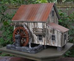 This old mill birdhouse complete with waterwheel is about the coolest garden birdhouse I've seen.