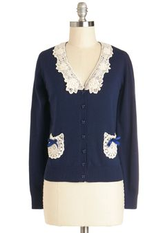i really like this too!!!  Not Un-lace There Are Bows Cardigan in Navy, #ModCloth