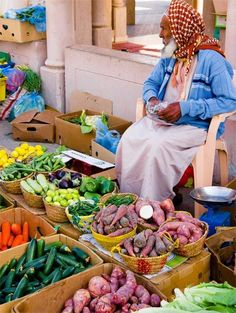 Travel Inspiration for Oman - A vegetable seller at Nizwa market in Oman
