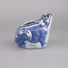A Chinese porcelain blue and white frog form vessel. Wanli, 1573-1619