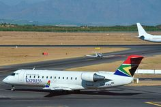 South Africa, South African Express' Bombardier ZS-NMK at Cape Town International Airport.reminds me of flights with Nadge and Ashley:) Commercial Aircraft, Aeroplanes, African Animals, Airports, International Airport, Cape Town, Landing, South Africa, Southern