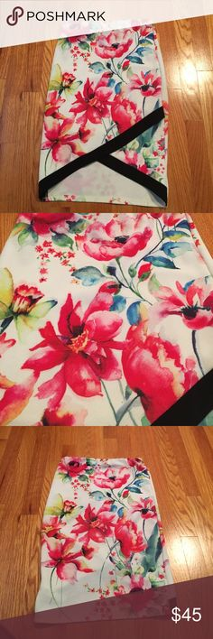 Floral skirt. HOST PICK! Floral high low skirt with opening in the front. 96% polyester 4% spandex. 26 inch waist. Form fitting. The longest part is 23 inches. The shortest part in the middle is 19 inches Skirts