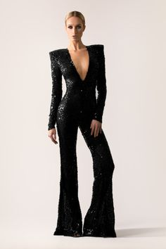 30bafce28482 Flared leg sequin jumpsuit with strong shoulders  amp  closed back.