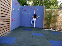 A rock climbing wall is not the simplest project, but the idea here is to consider adding something your children can climb on. If your budget won't allow a full-blown wall, perhaps you can add a few large boulders.