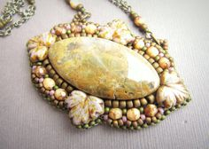 Love the use of leaves on this bead embroidered pendant.  Etsy item.