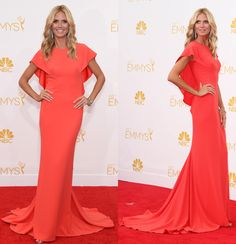 """Effortless"" and ""chic"" don't often go together, but that's the best way to describe Heidi Klum's coral Zac Posen gown. The sexy frock featured a form-fitting silhouette and a draped cape. To finish off the sophisticated look, the ""Project Runway"" host star rocked Jimmy Choo shoes and Lorraine Schwartz jewelry."