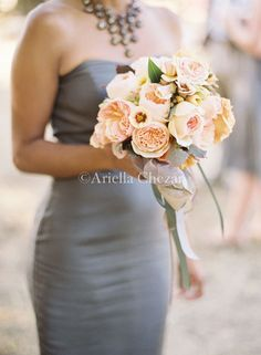 love peachy flowers with gray bridesmaid dresses.. Thats cute!! Never would choose gray on my own but i like the look of this...