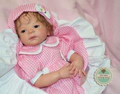 "This little custom ordered baby is DAWN. She was made from Sheila Michael's ""Victoria"" sculpt. Dawn is 23"" long, weighs 7 lbs. 1 oz. and is a full body, anatomically correct little girl. She has dark blue German glass eyes and light fawn brown hand-rooted mohair curls. Little Dawn lives in VIRY CHATILLON, FRANCE. See her at www.heartstringsnursery.com"