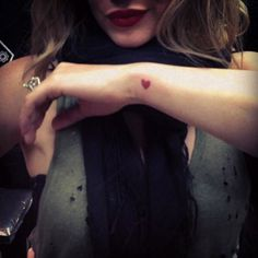 So many things I love about this pic! That cute tattoo, her hair, her gorgeous red lipstick, THAT RING, and her scarf ♥ #girlcrush [ Hilary Duff ] via The 33 Most Adorable Tiny Tattoos in Hollywood