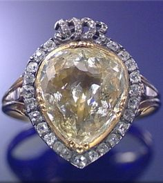 Diamond ring from the second half of the 18th century. Set with a foil backed pear-shaped diamond of yellow tint within cushion-shaped surrounds, surmounted by entwined initials HR embellished with rose-cut diamonds.