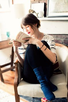 Red lipstick, messy bun, a striped shirt, cozy socks. Photo by Jamie Beck. Love it!