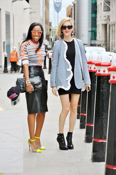 30+ Daring Style Snaps Straight From London #refinery29  http://www.refinery29.com/london-fashion#slide-17  Shiona Turini and Joanna Hillman mug for the camera. We're loving Shiona's Westward leaning specs.Photographed by Melanie Galea
