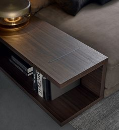 Poliform_Bristol system includes a series of sideboards with open compartment which can be equipped with cable arrangements for video and audio systems. Here a detail of the side table next to the chaise longue unit.