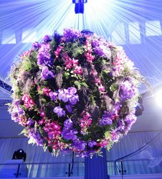 What a great new way to add flowers to your decor!  Flower disco ball?