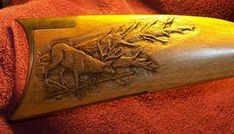 deer-carving-on-kentucky-rifle