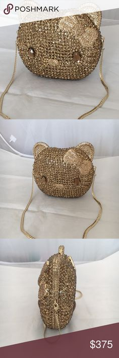 Hello Kitty Diamond Crystal clutch NEW Hello Kitty Diamond Crystal clutch purse. Removable golden chain, gold satin lining and extra crystals. Kitty's face is on both sides. The multi facets in these stones make this piece glisten and make it a real eye catcher. Snap magnetic closure. Rare and collectible. Never worn. Bags Clutches & Wristlets