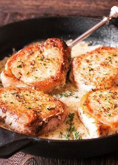Pork Chops in creamy garlic and herb wine sauce.