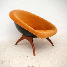 Anonymous; Fiberglass and Wood Lounge Chair by Lurashell, 1960s. I got one of these...different upholstery though