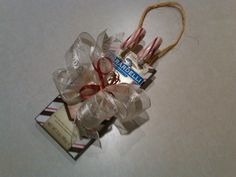 Christmas Sleighs - Ghirardelli chocolate bars, two candy canes, some twine and a bow!