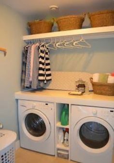 I prefer to have a bar that hangs all the way across both washer and dryer vs shelving units above. Do away with the shelf at the top and put the washer and dryer on a pedestal for storage underneath and this would be perfect!