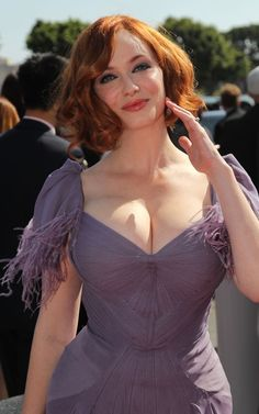 Christina Hendricks Emmys 2011. Size 14 and no designers would loan her a gown. An incredible shame because she is an amazing beauty and a feminine icon.