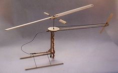 """""""Penni"""" rubber band-powered helicopter with a belt-driven tail rotor for stability—just like a real helicopter. Designed in 1969 by John Burkam, a Boeing engineer."""