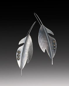 Hey, I found this really awesome Etsy listing at https://www.etsy.com/il-en/listing/125386618/silver-feather-architectural-earrings