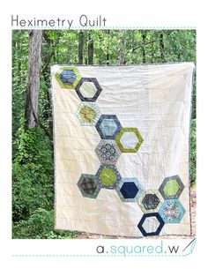 Heximetry cover by a²(w) - pattern included. Besides the fabulous hexies, I love the detail on the white part of these quilts... lovely