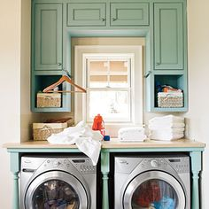 Laundry organization.  I love the upper cabinets with matching table