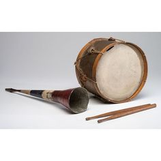 A Painted Tin Toy Drum and Horn