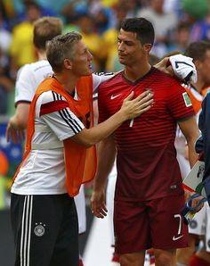 Bastian Schweinsteiger comforting the losers at the Fifa World Cup 2014