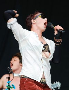 Whoops! Amanda Palmer's breast escaped her bra while she performed on stage at Glastonbury festival on Friday