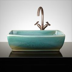 The Lavrador Vessel Sink features freckled accents across its teal surface. When purchasing a vessel sink faucet, ensure the height to spout and spout reach will accommodate your sink. To care for your hand-glazed sink, clean with a non-abrasive cleaner. Glass Bowl Sink, Vessel Sink, Bathroom Furniture, Bathroom Interior, Small Bathroom Tiles, Bathrooms, Bathroom Sinks, Natural Wood Trim, Small Half Baths