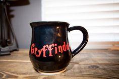 Harry Potter Mug, Gryffindor, Coffee mug, Black and red mug, Wheel thrown pottery mug, Stoneware mug, Handmade mug by TurtleRok on Etsy https://www.etsy.com/listing/277682360/harry-potter-mug-gryffindor-coffee-mug