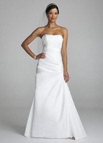 Modern decadence meets old world elegance in this gorgeous taffeta beaded gown!  Strapless taffeta bodice features intricate beaded lace applique detail.  Side draping helps create an ultra-flattering silhouette.  Sweep train. Available in Soft White.  Fully lined. Back zip. Imported polyester. Dry clean.