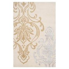"""Stylishly anchor your living room or master suite with this lovely hand-tufted New Zealand wool rug, showcasing an oversized damask motif on a winter white background.  Product: RugConstruction Material:  New Zealand woolColor: Winter white  Features: Hand-tufted  Pile Height: 0.63""""  Note: Please be aware that actual colors may vary from those shown on your screen. Accent rugs may also not show the entire pattern that the corresponding area rugs have."""
