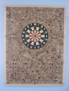 Cork Dart Board Wall protector. This is a great idea! No more holes in the walls from my bad throws!