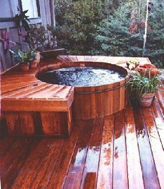 red wood hot tub elevated on matching floor direction