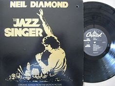 """NEIL DIAMOND ~ 1980 """"The Jazz Singer"""" commercial stock vinyl soundtrack album release (Capitol SWAV-12120) in NEAR-MINT COND. (no marks, no scratches, no fingerprints).  Contains the 3 monster hits """"Love On the Rocks"""", """"Hello Again"""", and """"America"""", plus popular """"Summerlove"""".  ($19.99)  Amazon.com"""